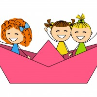 Cute little girls in paper boat